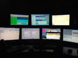 Communications Division Workstation with Seven Different Computer Monitors