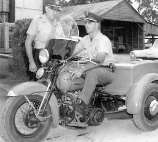 A Three-Wheel Police Motorcycle in Front of the Police Department- Circa Early 1950S