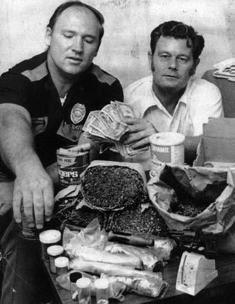 Odell Headrick and Detective Bob Hendrix display a drug seizure- Circa early 1970s